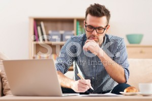 stock-photo-32837114-portrait-of-focus-man-working-at-home