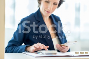 stock-photo-65047529-young-female-bank-officer-at-work (1)