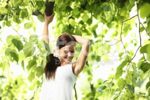 stock-photo-15146268-relaxed-woman-enjoying-the-nature-in-green-forest