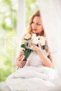 stock-photo-83740129-woman-holding-bunch-of-roses