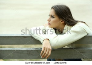 stock-photo-young-lonely-woman-on-bench-in-park-159857975