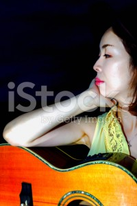 stock-photo-80241789-woman-playing-guitar