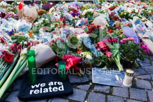 stock-photo-78886685-flowers-candels-and-notes-outside-french-embassy-after-terror-attack-