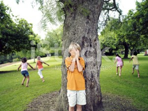 stock-photo-49134342-boy-with-hands-covering-eyes-playing-hide-and-seek