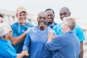 stock-photo-55768606-african-american-man-being-congratulated-by-friends