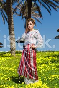 stock-photo-21672418-muslim-girl-standing-in-a-beautiful-garden