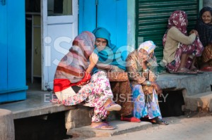 stock-photo-60416580-indian-women-sit-and-chat-on-a-house-porch