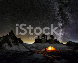 stock-photo-78479607-loneley-camper-under-milky-way-at-the-three-pinnacles